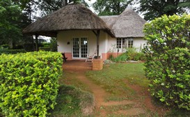 Pennygum Country African Dream Cottage image