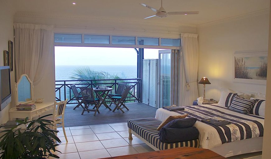 Tiffany's Suite is spacious with big, glass, sliding fold up doors leading out to the private undercover wooden deck, with patio furniture in Ballito, KwaZulu-Natal, South Africa