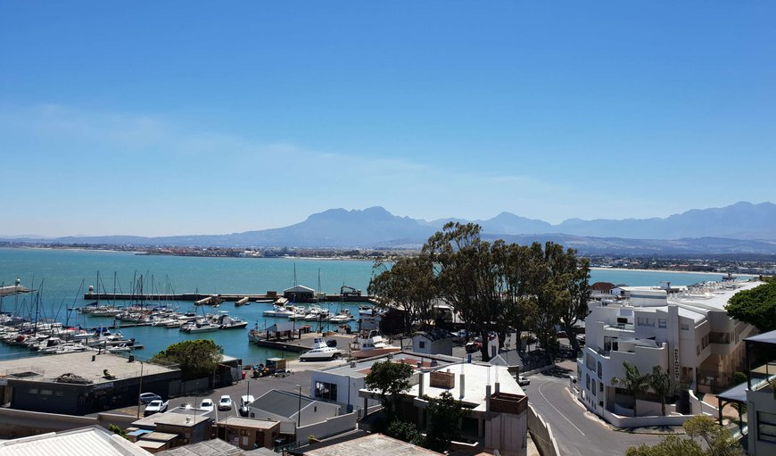 Harbour view from your balcony at Linga Longa.  1 minute walk to the blue flag Bikini Beach where swimming is heavenly! in Gordon's Bay, Western Cape, South Africa