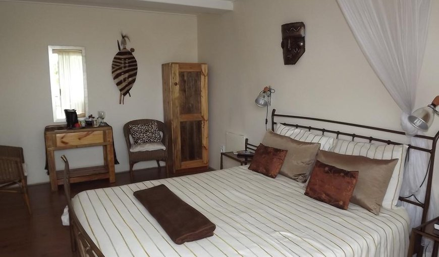 The room has a double bed with en-suite bathroom