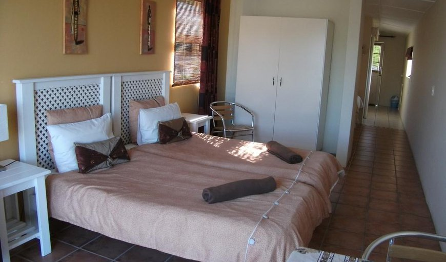 The room has a twin single bed with en-suite bathroom