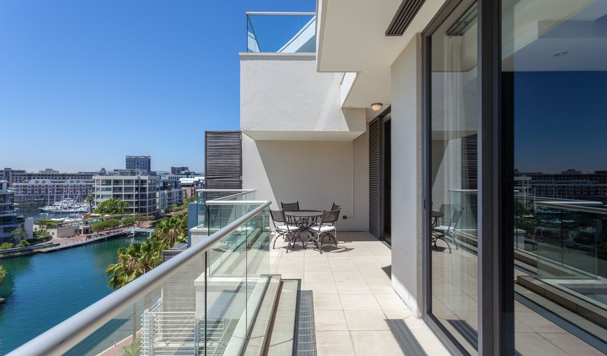 606 Juliette B features a balcony with spectacular views and an outdoor dining table.
