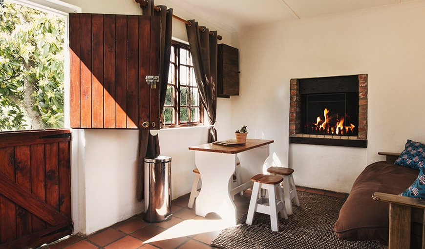 The beautiful lounge with fireplace in River Cottage