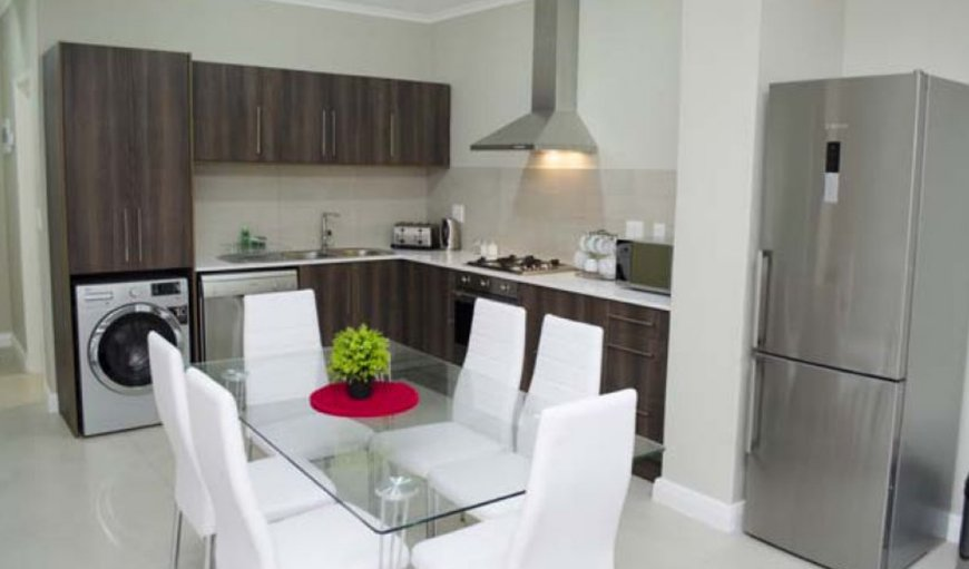 Kitchen and dining area. in Century City, Cape Town, Western Cape, South Africa