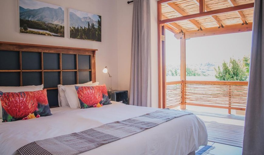 Bedroom with a double bed. in Swellendam, Western Cape, South Africa