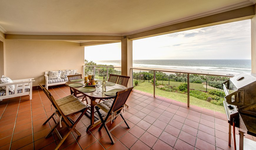 Wide terrace with 180 degree sea-view, outdoor furniture and a gas barbeque.