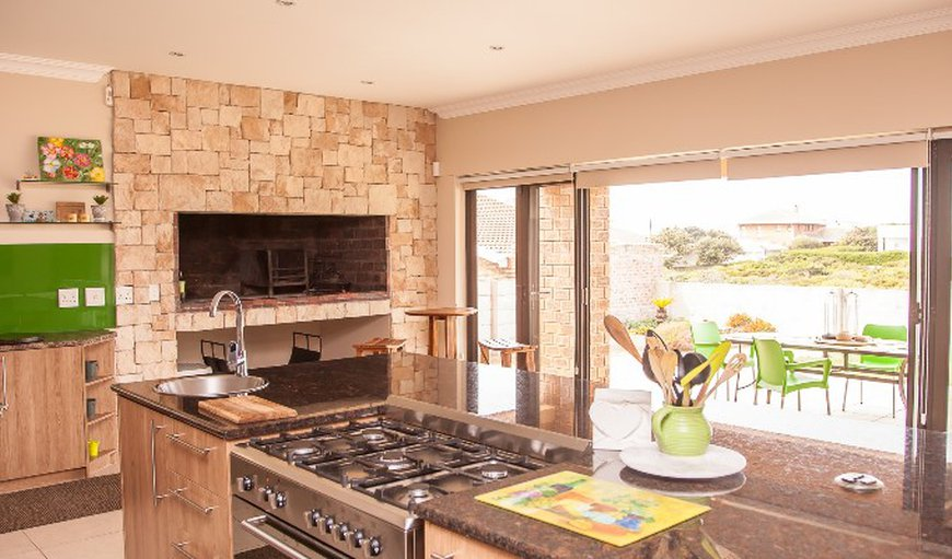 Open plan living area with fireplace in Yzerfontein, Western Cape, South Africa