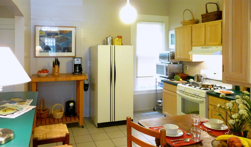 Eat In Kitchen with Garden View + Dishwasher & Laundry Room.