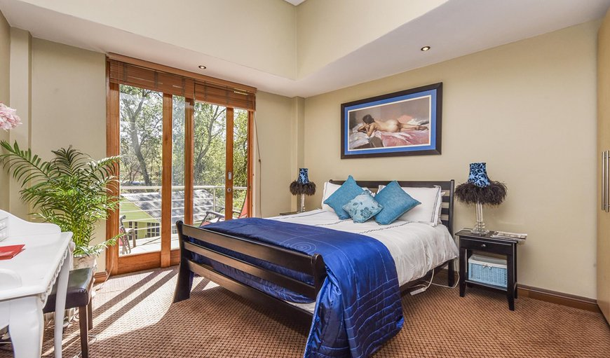 Bedroom with balcony overlooking river in Randburg, Gauteng, South Africa