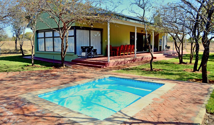 Welcome to Crimson Bush Lodge Deluxe Chalet in Dinokeng Game Reserve, Gauteng, South Africa