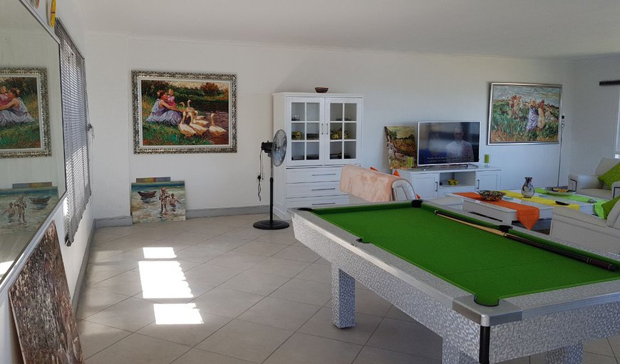 The house has an entertainment area with pool table, DSTV and WIFI.