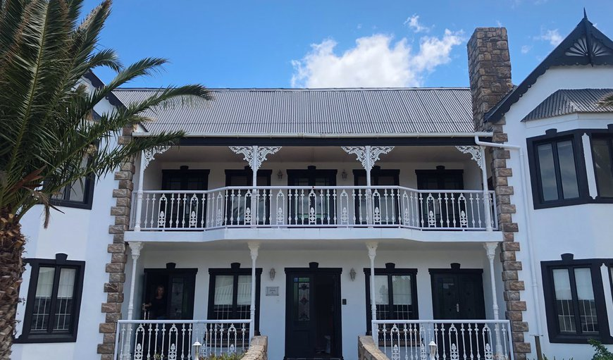 The main house from the outside. The two appartments are on the ground floor (Units 1 and 2) and unit 3 consists of the entire upper floor with 3 balconies. in Kleinmond, Western Cape, South Africa