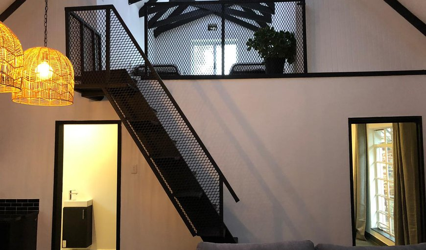 Wynland living area & stair way to loft