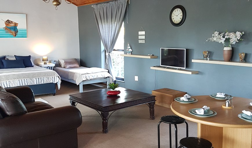 There is a queen size bed and a single bed in the open plan lounge area in Stellenbosch, Western Cape, South Africa