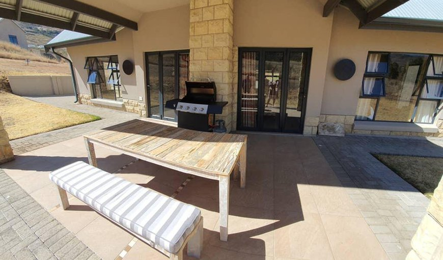 Cute and Quirky Clarens features a patio with an outdoor dining and braai area