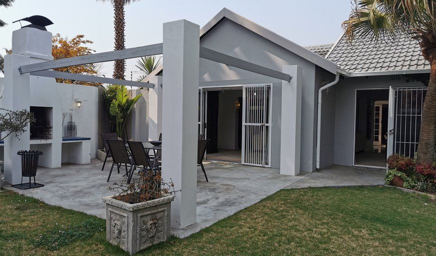This beautiful holiday home features a patio with a braai area