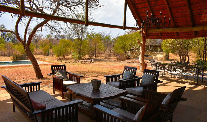 The covered verandah contains an outdoor seating and dining area in Bela Bela (Warmbaths), Limpopo, South Africa