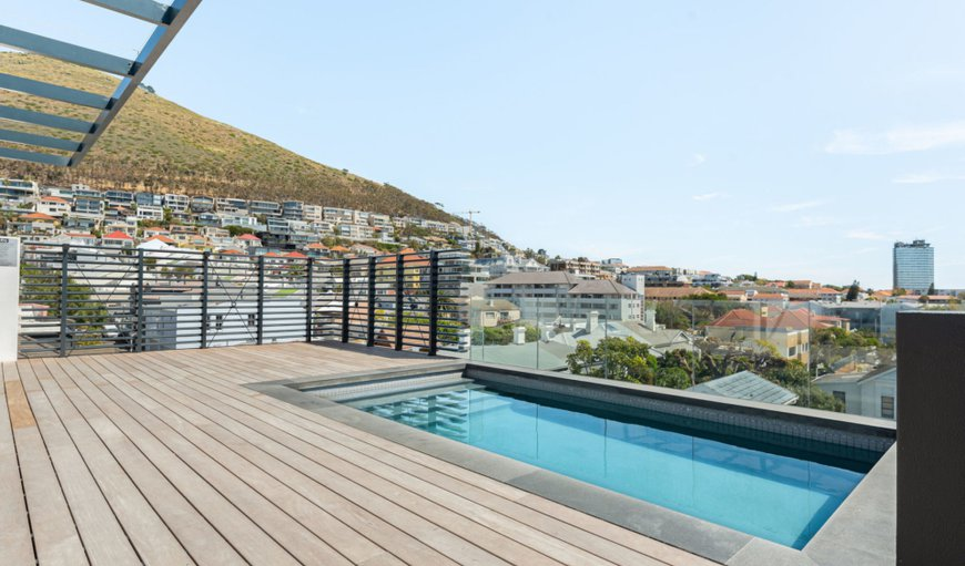 Condo LaView features a communal rooftop swimming pool with stunning views