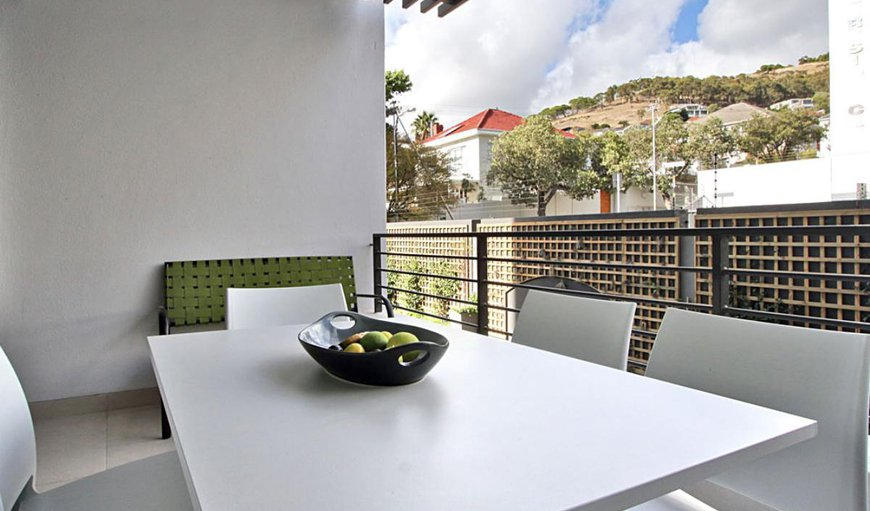 The apartment features an outdoor dining area with beautiful views