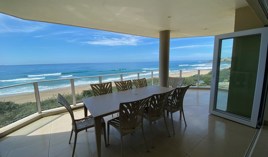 The unit features a large enclosed balcony with a gas braai