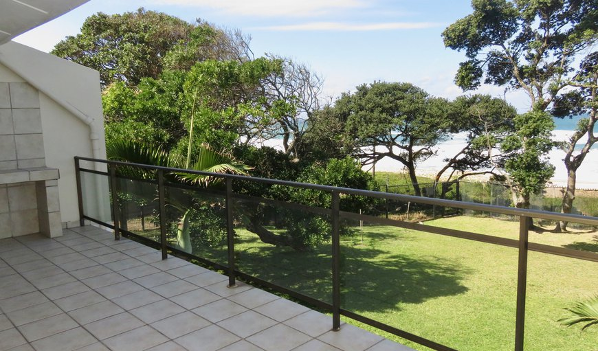 The unit features a balcony with a gas braai