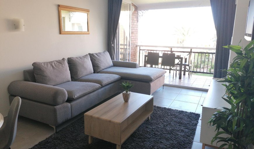 The lounge area is tastefully furnished with a comfortable couch and a TV