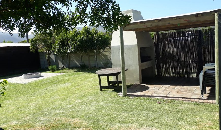 Enclosed backyard with with an outside braai/BBQ