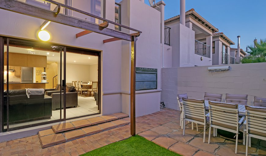 The lounge has a sliding door that leads to a patio area, built in BBQ an 8 seated dining table; this private garden is great for entertaining