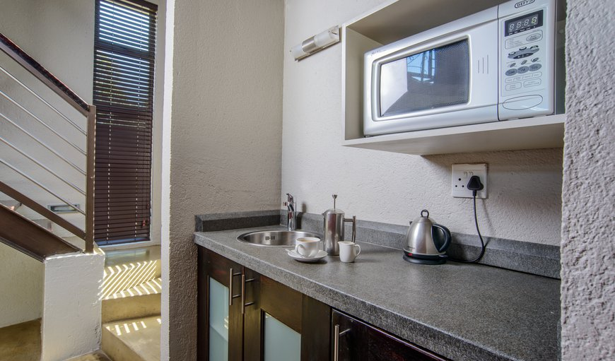 Each room with Kitchenette with microwave and fully stocked minibar and snack bar