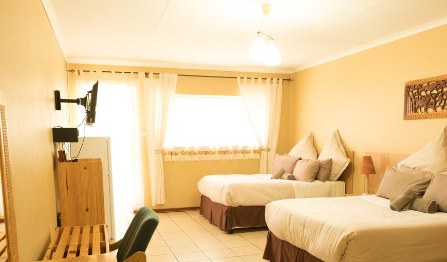 2 x Double or Queen Beds; Fridge, Coffee Station, Shower En-Suit; Air-conditioner, DSTV