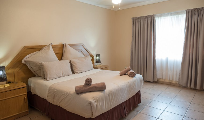 A standalone unit with a Queen Bed, Two Single Beds, Kitchenette with a Fridge, Microwave and Gas Stove; Shower E-Suit, DSTV and Private Patio.