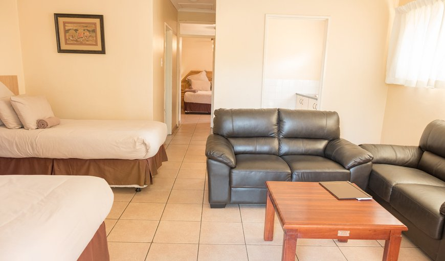 A standalone unit with a Queen Bed, Two Single Beds, Kitchenette with a Fridge, Microwave and Gas Stove; Shower On-Suit, DSTV and Private Patio.