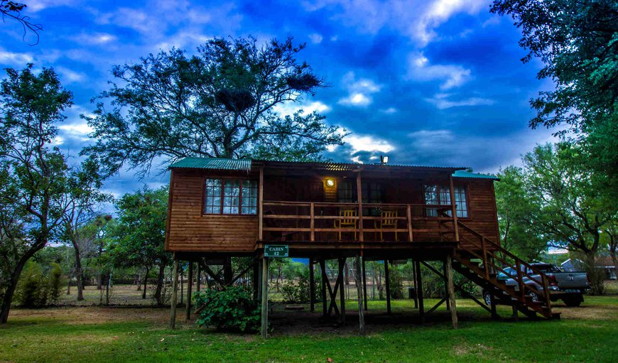 On stilts, 2.5 meters above ground. Two bedrooms with two ¾  beds in each bedroom; two shower on-suit bathrooms; open plan kitchenette / lounge with two sleeper couches; coffee station; Fridge; Microwave; DSTV in the lounge; Private Patio.