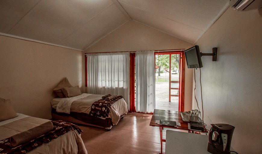 with 2 x 3/4 Beds; shower en-Suit; coffee station; fridge; DSTV and private patio.