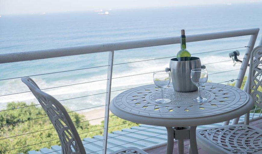 Guests can relax by the outdoor dining area on the balcony and enjoy the spectacular views.