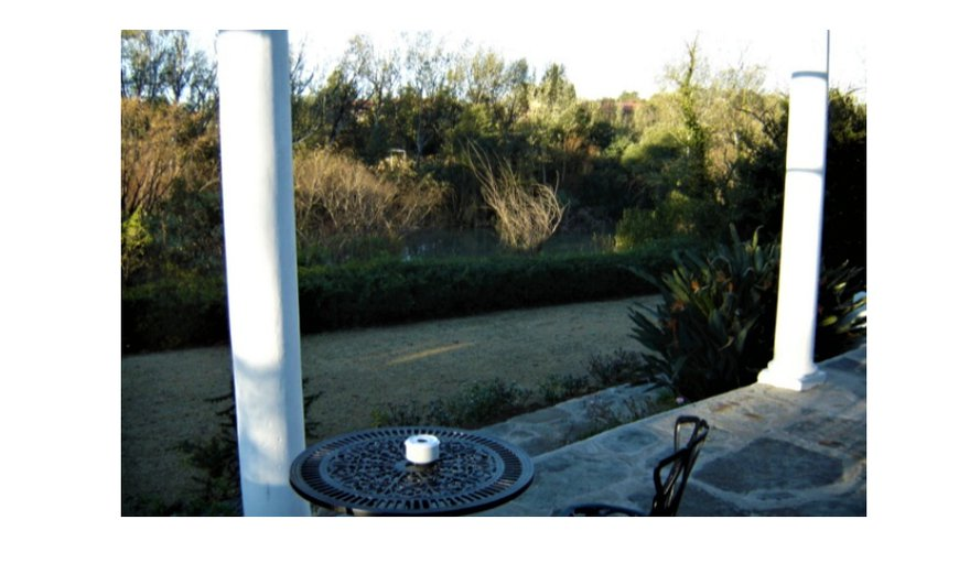 Set in a huge garden, with a magnificent 20 m verandah overlooking the Bushman's River in Estcourt.