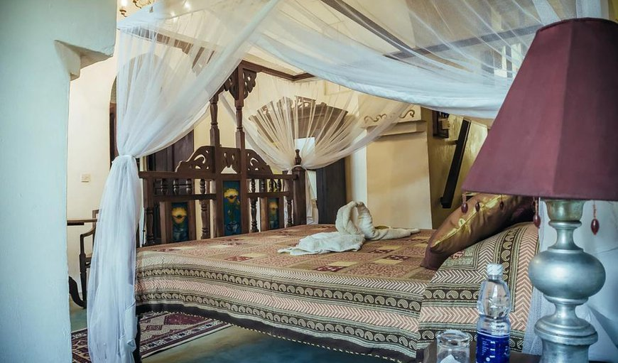 Cappuccino deluxe bedroom suite - tastefully decorated adding an exotic flare to your holiday