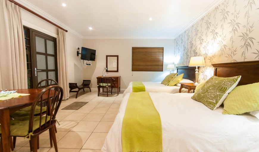 Room with two double beds, full bathroom, kitchenette, free wi-fi, satellite TV, flat screen TV.