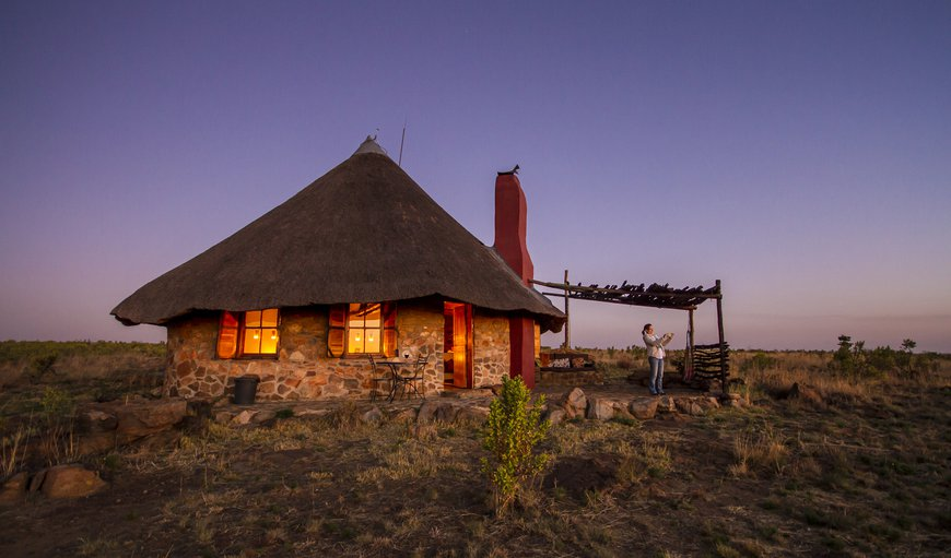 Agama cottage in the evening with candles ablaze in Magaliesburg, Gauteng, South Africa