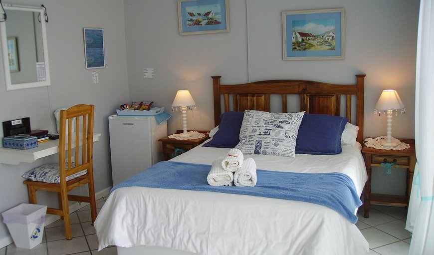 Beach room- Experience an atmosphere of tranquility in this lovely blue room with a view of a Fynbos garden.