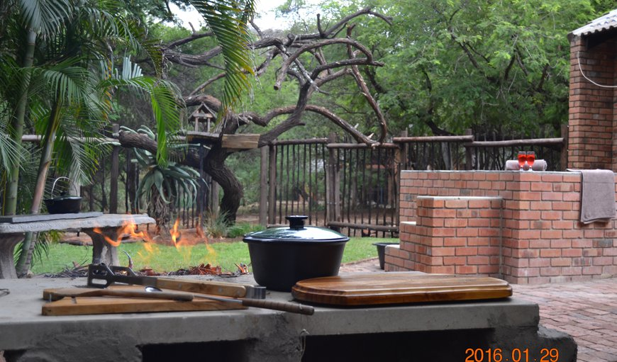 Safely enclosed entertainment area, with splash pool, braai / BBQ