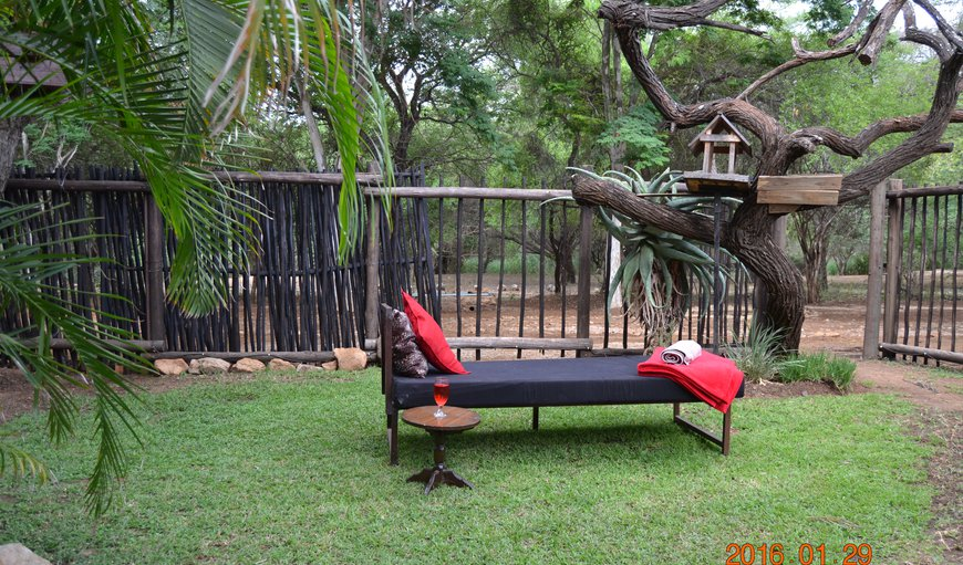 Day bed placed in the garden, to read and watch the animals walk past the house