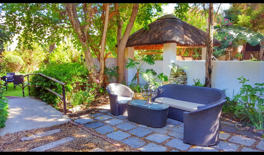 The garden is beautiful and offer outdoor seating area for guests to relax in