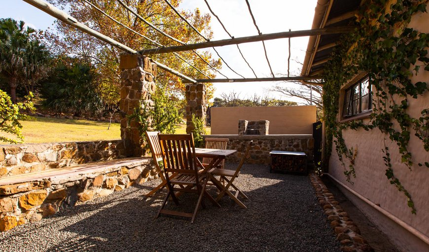 Situated just outside the Dining/Kitchenette area this braai area has views of the mountain and gardens.